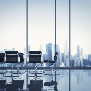An accountant's boardroom with a view over a city